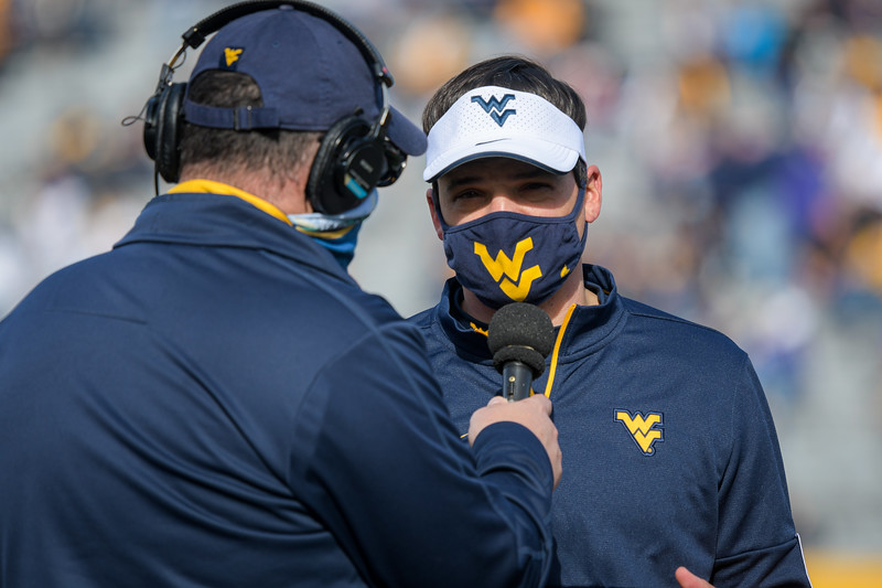 WVU footbal coach Neal Brown gives a halftime radio interview during a game against TCU, Nov. 14, 2020. Photo: Geoff Coyle