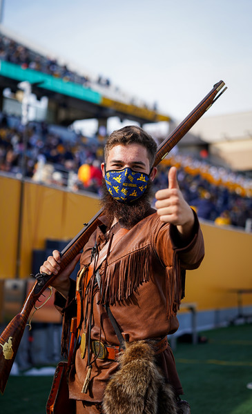The WVU Mountaineer Mascot, Colson Glover, gives a thumbs up during the first half of a game against TCU, Nov. 14, 2020. Photo: Geoff Coyle