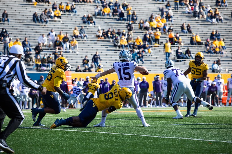 WVU defensive lineman Jeffery Pooler Jr. sacks the quarterback during WVU's home game vs Kansas State, Oct. 31, 2020. Photo: Corbin Mills