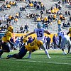 WVU defensive lineman Jeffery Pooler Jr. sacks the quarterback during WVU's home game vs Kansas State, Oct. 31, 2020. Photo: Corbin Mills
