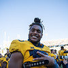 WVU defensive lineman Dante Stills celebrates after WVU's home win vs Kansas State, Oct. 31, 2020. Photo: Corbin Mills