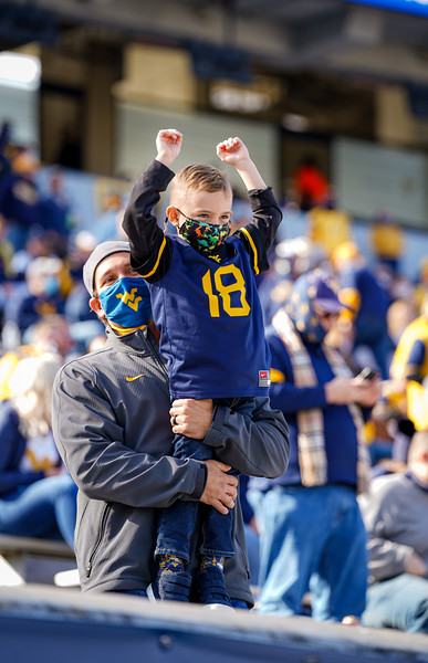 A young WVU fan celebrates a Mountaineer touchdown in a win over TCU, Nov. 14, 2020. Photo: Geoff Coyle