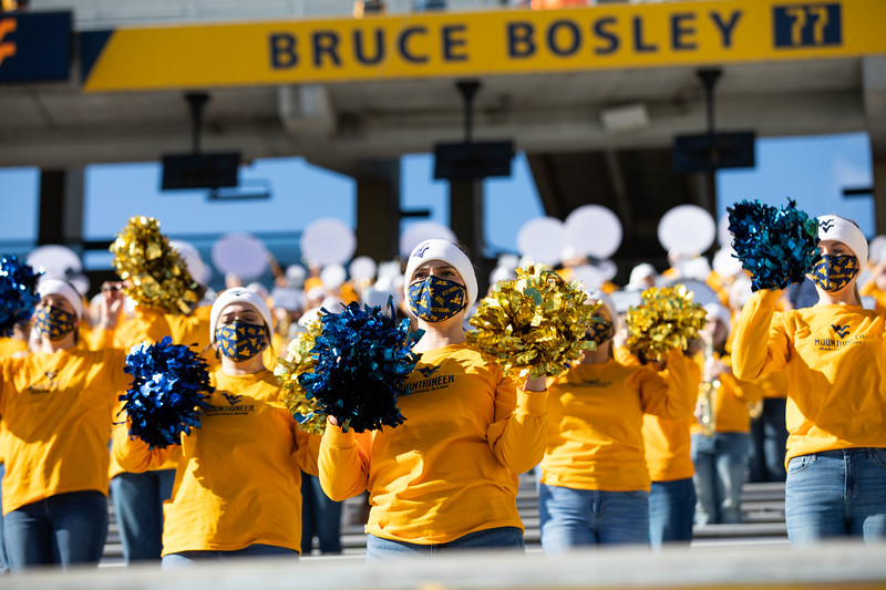 Members of the Pride of West Virginia cheer for the Mountaineers during their home game against Kansas State, Oct. 31, 2020. Photo: Corbin Mills