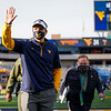 WVU football coach Neal Brown waves as he leaves the field after a win over TCU, Nov. 14, 2020. Photo: Geoff Coyle