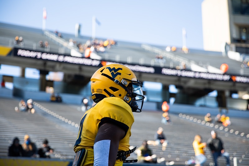 A WVU football player warms up prior to WVU's home game against Kansas State, Oct. 31, 2020. Photo: Corbin Mills