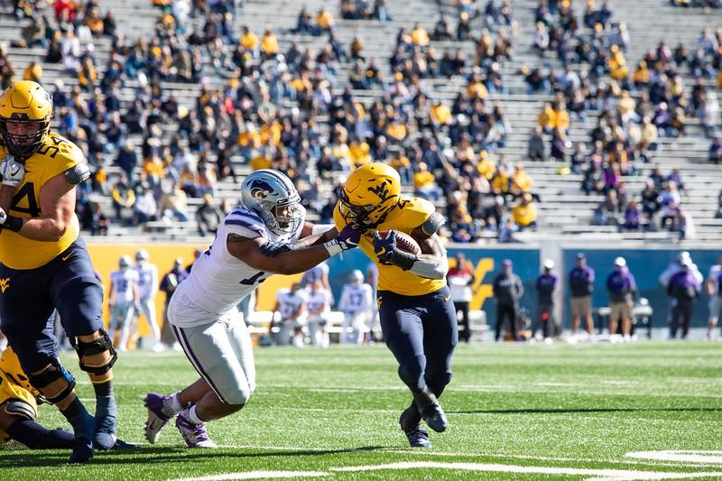 WVU running back Leddie Brown stiff arms a defender during WVU's home game against Kansas State, Oct. 31, 2020. Photo: Corbin Mills