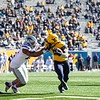 WVU running back Leddie Brown stiff arms a defender during WVU's home game against Kansas State, Oct. 31, 2020. Photo: Corbin Mills