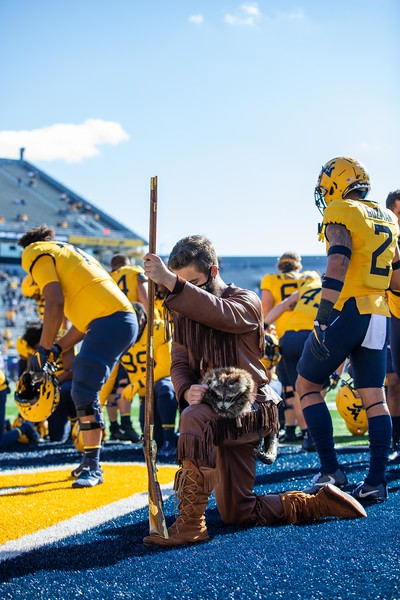 Mountaineer mascot Colson Glover reflects in the endzone on Mountaineer Field prior to WVU's home game against Kansas State, Oct. 31, 2020. Photo: Corbin Mills