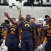 WVU football players sing Country Roads following a 56-10 win over Eastern Kentucky, Sept. 12, 2020. Photo: Geoff Coyle