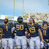 WVU football players sing Country Roads after a win over TCU, Nov. 14, 2020. Photo: Geoff Coyle