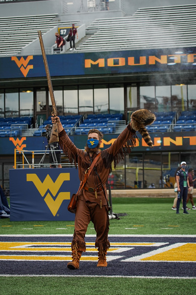 WVU Mountaineer Mascot Colson Glover fires the rifle to celebrate a season opening win over Eastern Kentucky, Sept. 12, 2020. Photo: Geoff Coyle