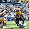 WVU running back Leddie Brown runs down the field during WVU's home game against Kansas State, Oct. 31, 2020. Photo: Corbin Mills