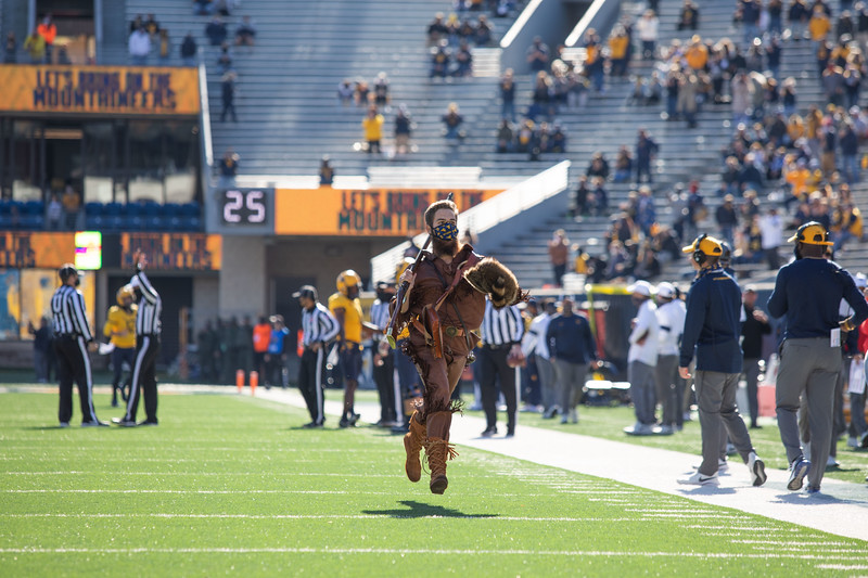 Mountaineer Mascot Colson Glover runs onto the field prior to WVU's home game against Kansas State, Oct. 31, 2020. Photo: Corbin Mills