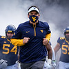 WVU football coach Neal Brown leads the Mountaineers onto the field before a game against TCU, Nov. 14, 2020. Photo: Geoff Coyle