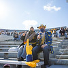Two masked WVU fans pose for a photo prior to WVU's home game against Kansas State, Oct. 31, 2020. Photo: Corbin Mills