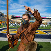 WVU Mountaineer Mascot Colson Glover leads the football team off of the field during pregame before a match-up with TCU, Nov. 14, 2020. Photo: Geoff Coyle