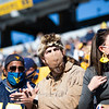 A masked WVU fan dressed as the Mountaineer cheers on the Mountaineers during their home game against Kansas State, Oct. 31, 2020. Photo: Corbin Mills