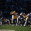 The WVU defensive line rushes the passer during WVU's home game against Kansas State, Oct. 31, 2020. Photo: Corbin Mills