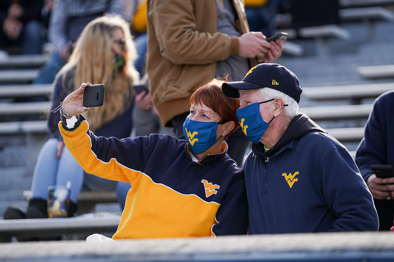Two WVU fans pose for a selfie during a home Mountaineer football game against TCU, Nov. 14, 2020. Photo: Geoff Coyle