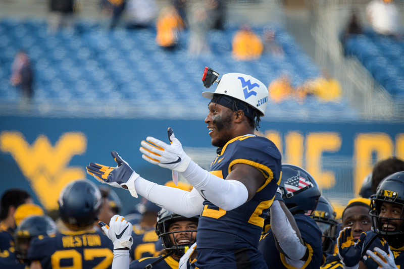 WVU defender Tykee Smith sports the Turnover Helmet as he celebrates a late interception in a win over TCU, Nov. 14, 2020. Photo: Geoff Coyle