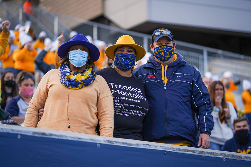 WVU fan Cynthia Johnson (center) poses with fellow supporters during a win over TCU, Nov. 14, 2020. Photo: Geoff Coyle
