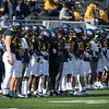WVU football players stand together for a moment of unity prior to kickoff against TCU, Nov. 14, 2020. Photo: Geoff Coyle