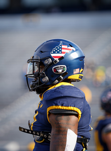 WVU running back Leddie Brown sports a special helmet in honor of Veterans Day for a game against TCU, Nov. 14, 2020. Photo: Geoff Coyle