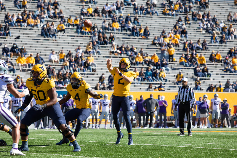 WVU quarterback Jarret Doege throws a pass during WVU's home game against Kansas State, Oct. 31, 2020. Photo: Corbin Mills