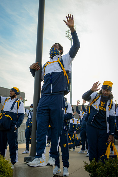 TJ Simmons (center) and the WVU football team wave to patients at WVU Medicine Children's prior to kickoff against TCU, Nov. 14, 2020. Photo: Geoff Coyle