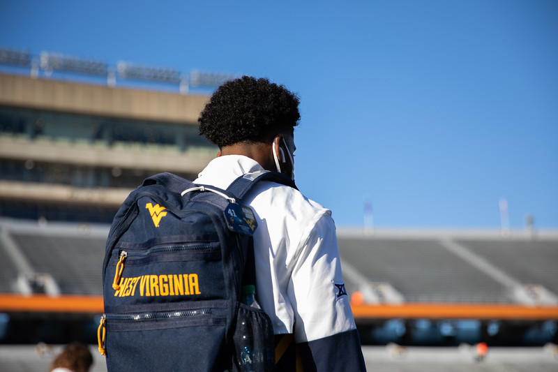 A WVU football player stands on Mountaineer Field prior to WVU's home game against Kansas State, Oct. 31, 2020. Photo: Corbin Mills