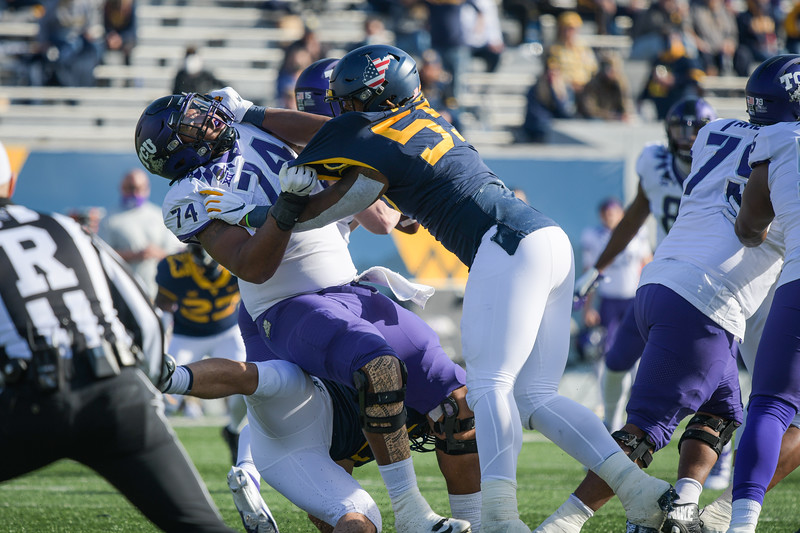 WVU defensive lineman Dante Stills pushes back a TCU offensive lineman in a win over the Horned Frogs, Nov. 14, 2020. Photo: Geoff Coyle