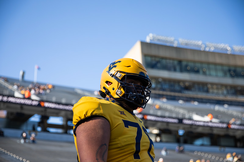 WVU football player Chase Behrndt warms up prior to WVU's home game against Kansas State, Oct. 31, 2020. Photo: Corbin Mills