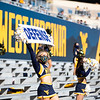 "A WVU cheerleader holds up a sign that reads ""DEFENSE"" during WVU's home game against Kansas State, Oct. 31, 2020. Photo: Corbin Mills"