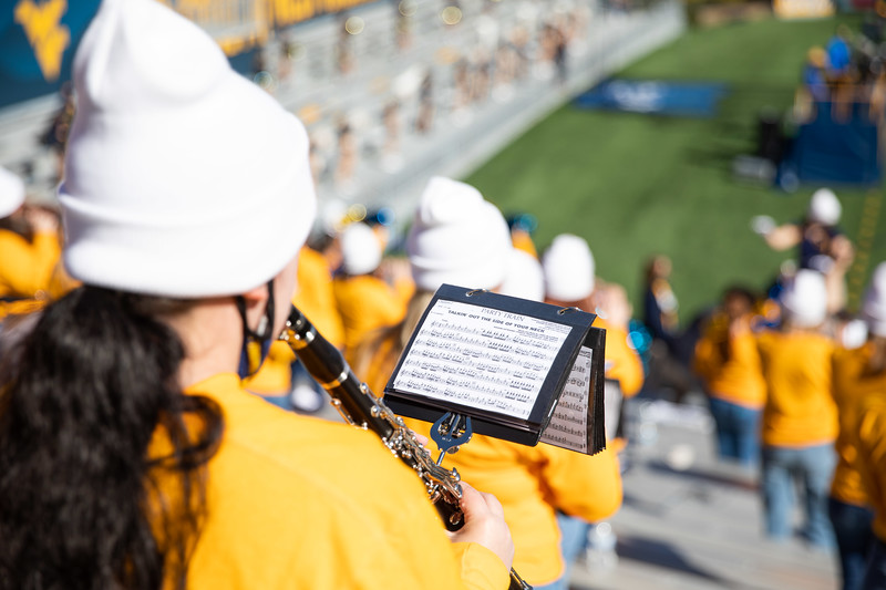 A member of the Pride of West Virginia plays an instrument during WVU's home game against Kansas State, Oct. 31, 2020. Photo: Corbin Mills