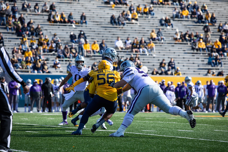 WVU defensive lineman Darius Stills sacks the quarterback during WVU's home game vs Kansas State, Oct. 31, 2020. Photo: Corbin Mills
