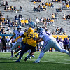WVU defensive lineman Darius Stills sacks the quarterback during WVU's home game vs Kansas State, Oct. 31, 2020. Photo: Corbin Mills