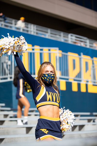 A WVU cheerleader cheers on the Mountaineers during WVU's home game against Kansas State, Oct. 31, 2020. Photo: Corbin Mills