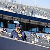 A masked WVU fan watches warmups prior to WVU's home game against Kansas State, Oct. 31, 2020. Photo: Corbin Mills