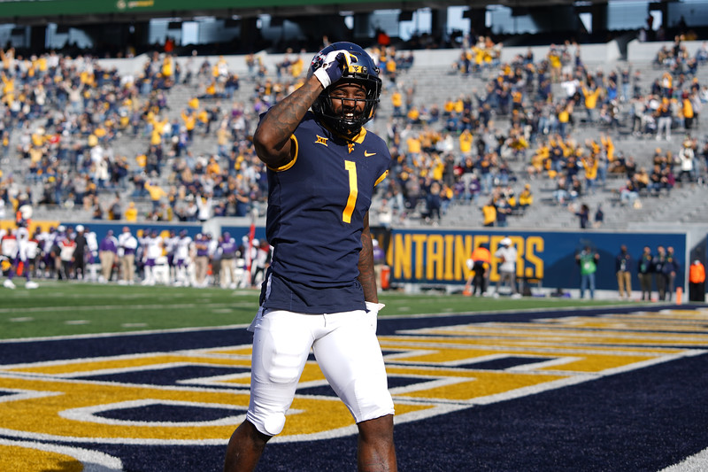 WVU receiver TJ Simmons celebrates his first of two touchdowns in a win over TCU, Nov. 14, 2020. Photo: Geoff Coyle