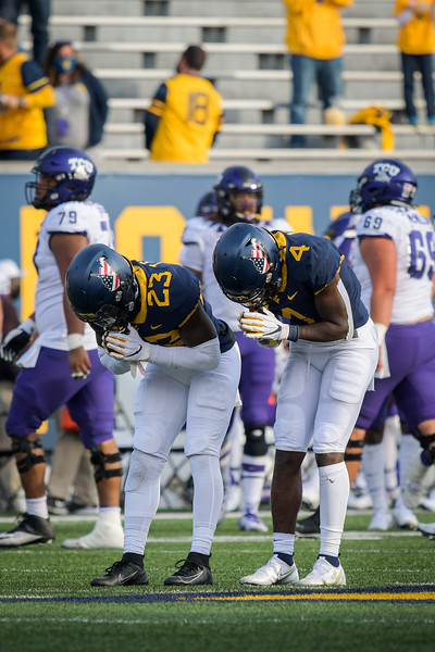WVU defenders Tykee Smith (left) and Alonzo Addae (right) take a bow in celebration of a second half turnover in a win over TCU, Nov. 14, 2020. Photo: Geoff Coyle