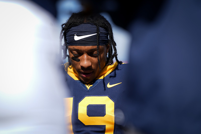 WVU receiver Ali Jennings joins teammates for a pregame prayer before the Mountaineers take on TCU, Nov. 14, 2020. Photo: Geoff Coyle