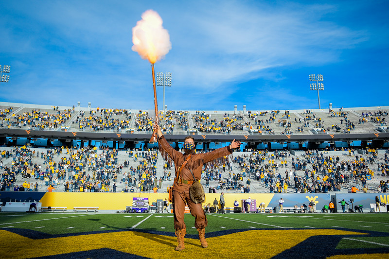 WVU Mountaineer Mascot Colson Glover fires the rifle to celebrate a win over TCU, Nov. 14, 2020. Photo: Geoff Coyle