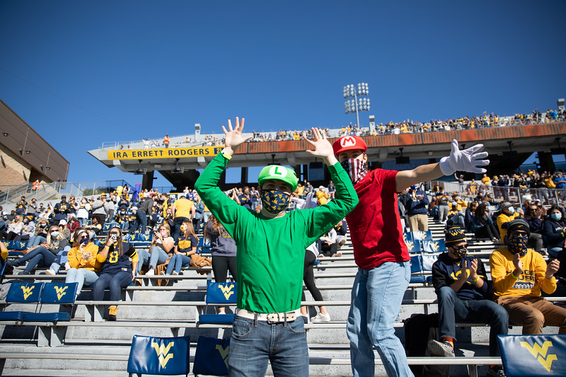 Two WVU students dressed in Halloween costumes cheer on the Mountaineers during their home game vs Kansas State, Oct. 31, 2020. Photo: Corbin Mills
