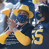 WVU fan Cynthia Johnson, left, cheers on the football team in a win against TCU, Nov. 14, 2020. Photo: Geoff Coyle