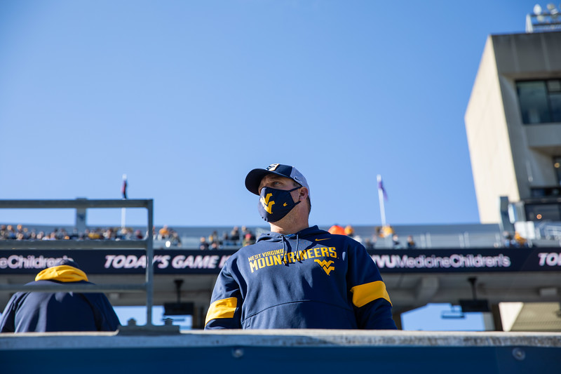 A masked WVU watches warmups prior to WVU's home game against Kansas State, Oct. 31, 2020. Photo: Corbin Mills