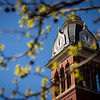 The Woodburn Hall clock tower on a sunny spring day at WVU, April 2, 2020. Photo: Geoff Coyle