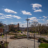 The U.S.S. West Virginia mast stands in the foreground of the Downtown campus on a sunny spring day at West Virginia University, April 2, 2020. Photo: Geoff Coyle