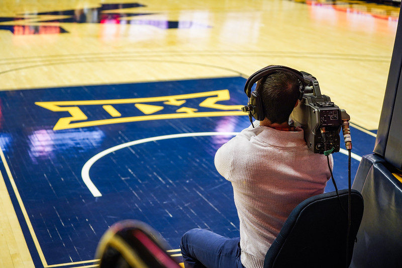 Geoff Coyle working the TV camera at a women's basketball game on Jan. 15, 2020.  Photo: Kallie Nealis.
