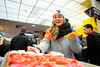 A student takes a cupcake from a Valentine's Day event in the Mountainlair, Feb. 14, 2020. Photo: Geoff Coyle