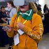 A prospective student steps on the field of Milan Puskar Stadium through virtual reality at WVU Day at the Legislature in Charleston, WV on Jan. 21, 2020. Photo: Kallie Nealis.